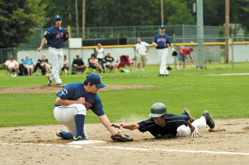 PICKED OFF: Braintree, Mass. first baseman Dylan Casserly tags out Essex, Vt.'s Josh Baez on a pickoff play in the opener of the New England Babe Ruth 13-15-year-old Babe Ruth New England Regional on Friday at Hippach Field, in Farmington.