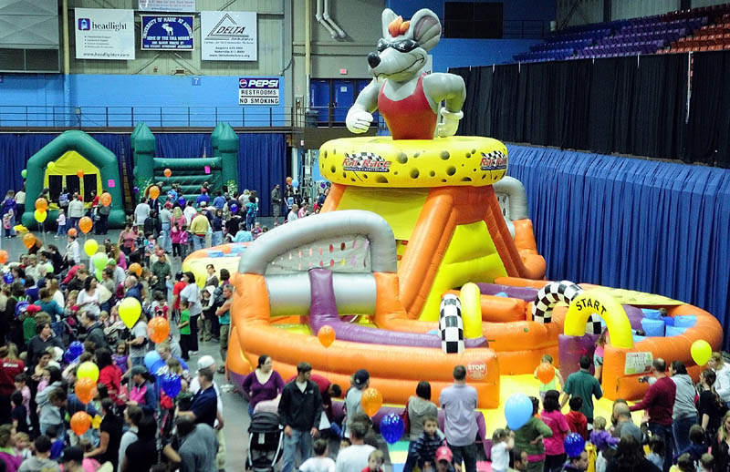 BOUNCING AROUND: There were several bounce houses at Kids Day in Capitol Park, held in Saturday at the Aguusta Civic Center.