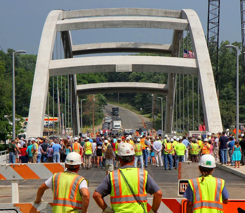 Maine Department of Transportation workers, spectators and dignitaries gather for a ceremony opening the new $22 million bridge Thursday in Norridgewock.