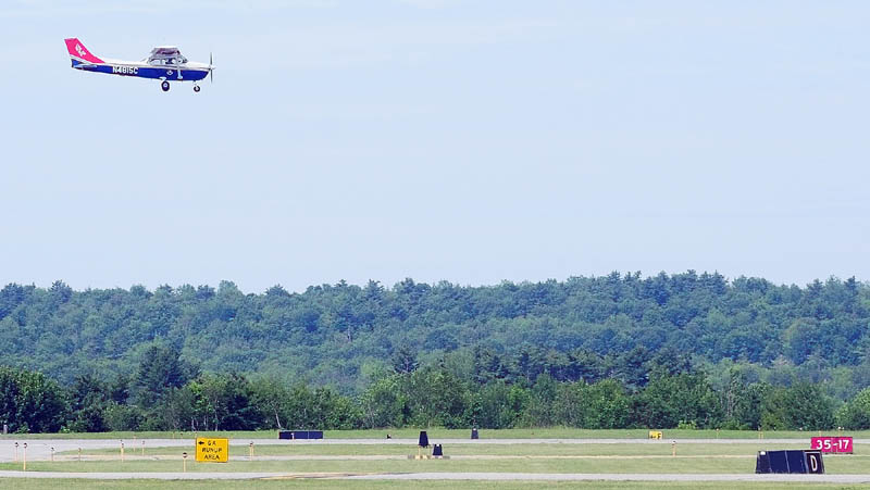 A Civil Air Patrol cadet takes a low pass over the Augusta State Airport on Tuesday morning.