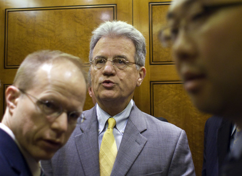 """WORKING OUT DETAILS: Sen. Tom Coburn, R-Okla., one of the so-called """"Gang of Six,"""" leaves the Senate floor on Capitol Hill in Washington on Wednesday. The details and impact of the plan, released this week by the bipartisan """"Gang of Six"""" senators, emerged as President Barack Obama called congressional leaders to the White House on Wednesday to determine, in separate meetings, their bottom line for extending the nation's debt limit while also cutting spending at the greatest amount possible. The role of additional tax revenue remained a sticking point."""