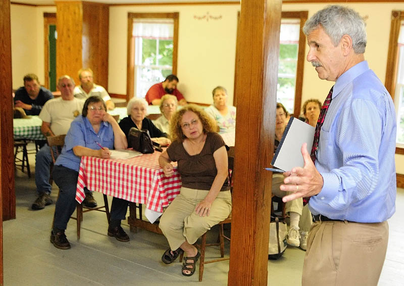 State Sen. Roger Katz, R-Augusta, speaks during a meeting about preventing the closure of the East Vassalboro Post Office held Wednesday night at at the East Vassalboro Grange Hall.
