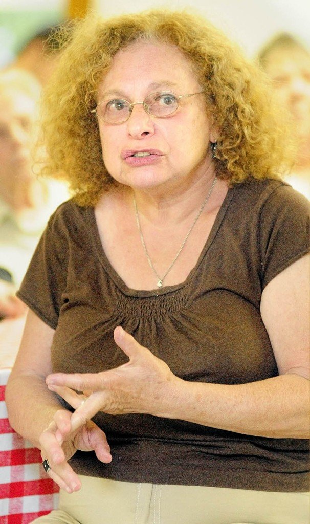 Vivian Flamm speaks during a meeting about preventing the closure of the East Vassalboro Post Office held Wednesday night at at the East Vassalboro Grange Hall.