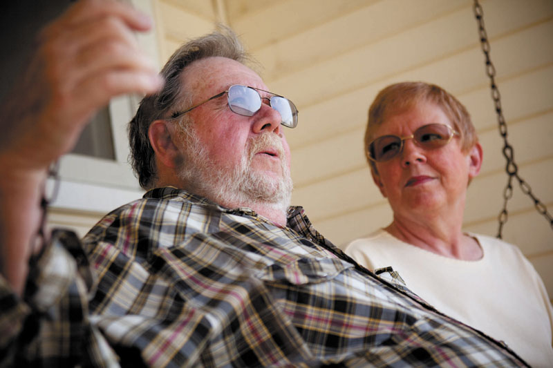 SAVINGS: Ray and Jo Kelly relax on a swing in front of their home last month in Conklin, Mich., where they live in retirement. The two both take Lipitor and look forward to having extra money when the drug is replaced with a generic in the fall.