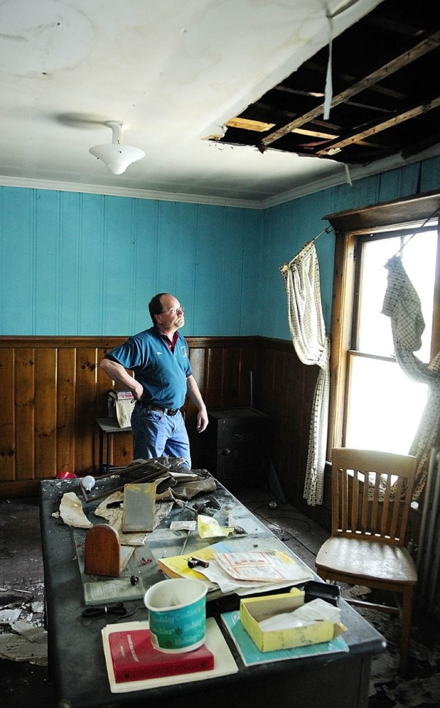 Hallowell Fire Chief Mike Grant stands in what used to be his second-floor office on Thursday during a tour of the Hallowell fire station. He quit using the office when the ceiling first collapsed, shortly after the ice storm of 1998.