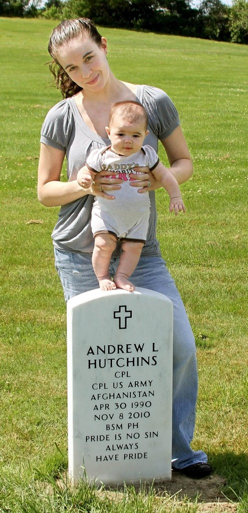 Heather Hutchins stands at the grave of her late husband, Andrew, with their 4-month-old daughter, Allyssa.
