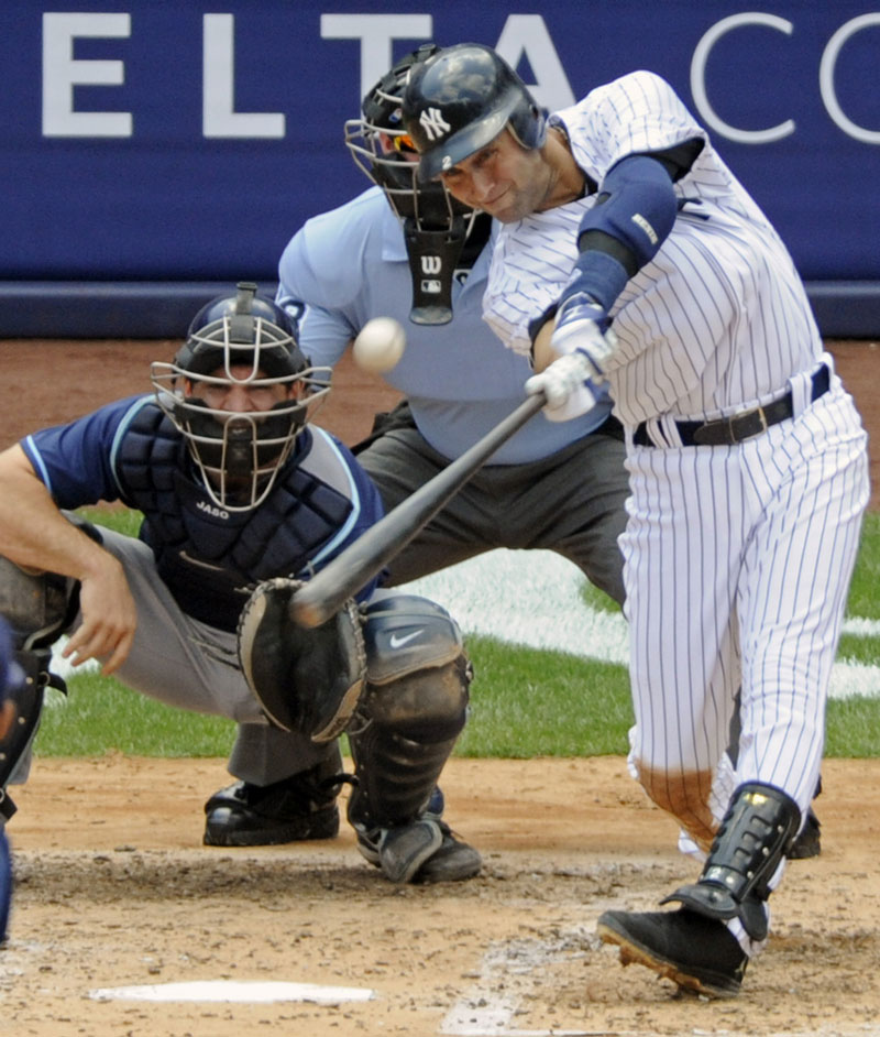 Mr. 3,000: Derek Jeter hits a home run for his 3,000th career hit in the third inning Saturday against the Tampa Bay Rays at Yankee Stadium in New York. Jeter became the first Yankee to reach 3,000 career hits.