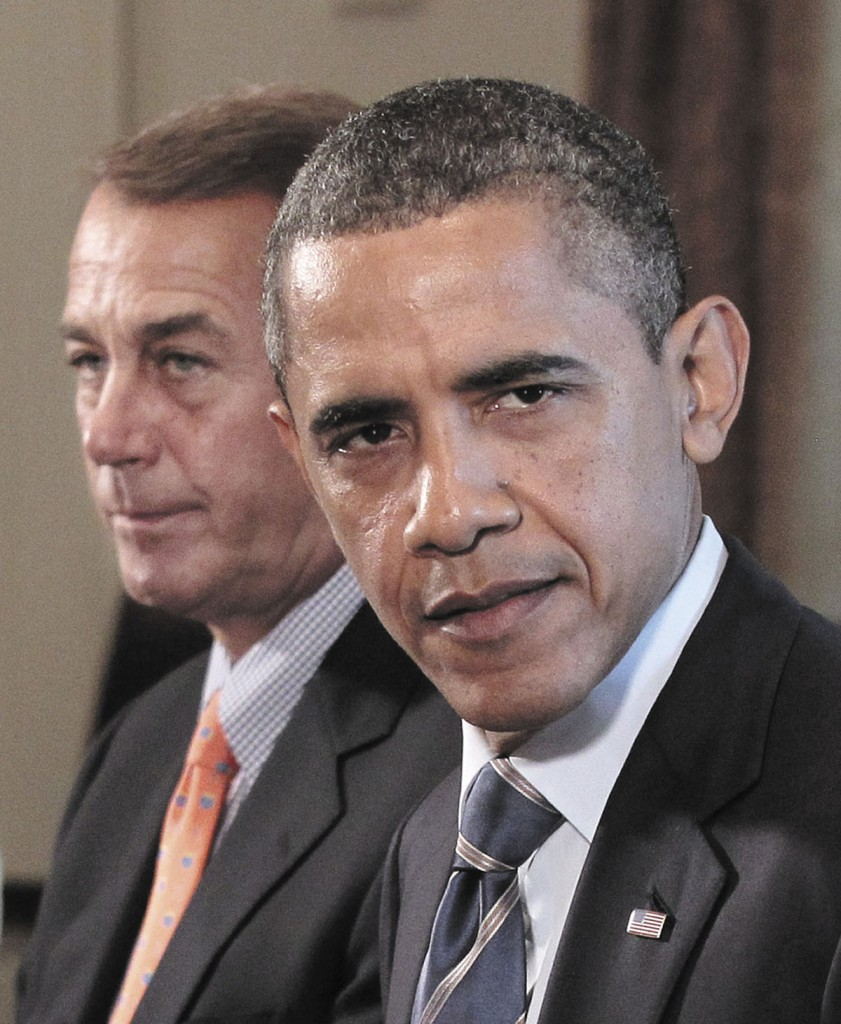 President Barack Obama and House Speaker John Boehner of Ohio take part in a meeting Thursday with Congressional leadership in the White House in Washington to discuss the debt.