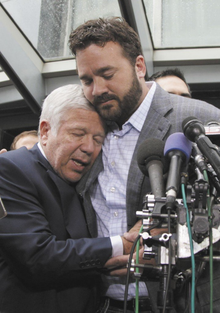 TOUCHING MOMENT: Patriots football owner Robert Kraft owner, left, is hugged by Jeff Saturday of the Indianapolis Colt during a news conference Monday in Washington after the NFL Players Association executive board and 32 team reps voted unanimously to approve the terms of a deal with owners to the end the 41⁄2-month lockout.