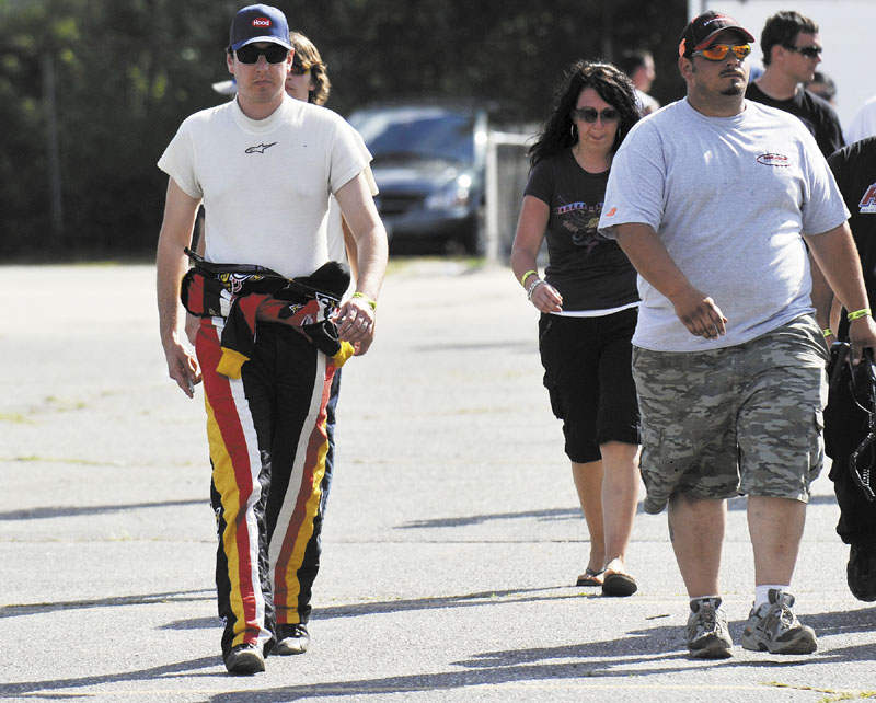 READY TO RACE: Kyle Busch walks in the pits before the start of the TD Bank 250 on Sunday at Oxford Plains Speedway.