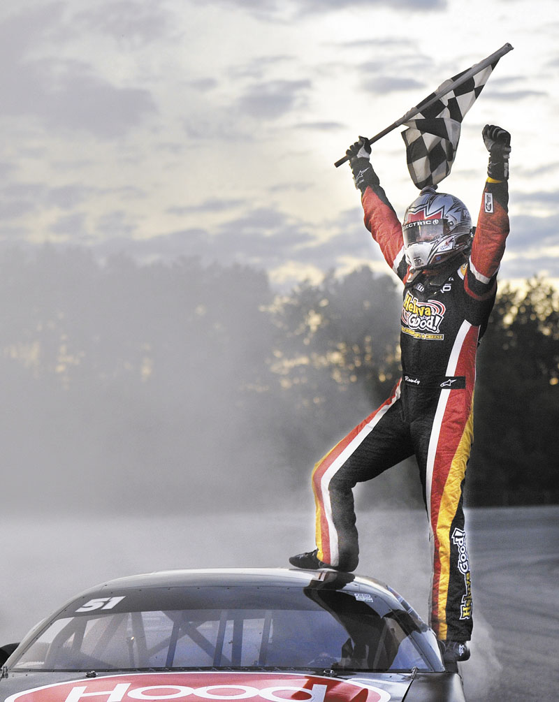 VICTORY IS MINE: Kyle Busch celebrates after winning the TD Bank 250 on Sunday at Oxford Plains Speedway.