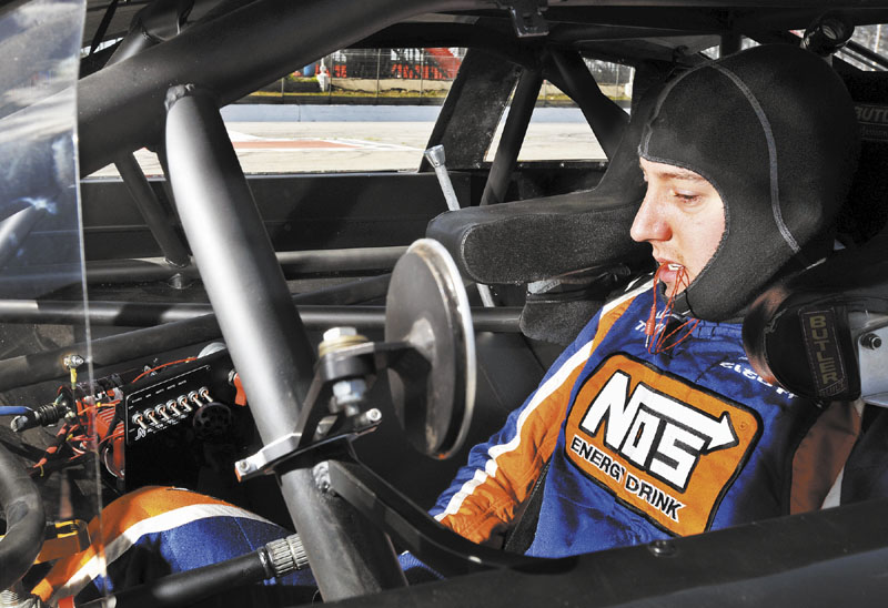 CHECKING THINGS OUT: NASCAR driver Kyle Busch settles into his car at the Oxford Plains Speedway on Thursday during testing for the upcoming TDBank 250 at the Oxford Plains Speedway.