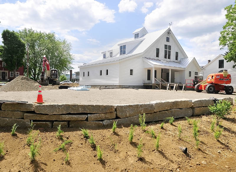 The new Maine Lakes Resource Center is nearing completion in Belgrade Lakes village. Some residents, however, are trying to stop plans by the center to remove a marina.
