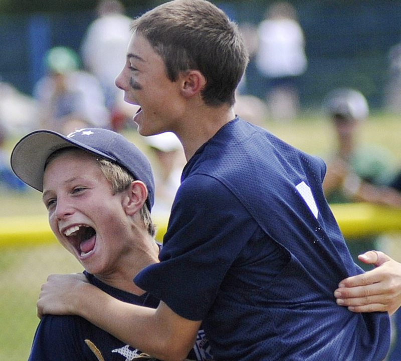 Jack Snyder, left, and Noah Pellerin of Yarmouth celebrate after Yarmouth beat York 6-3 today to win the state Little League championship at Portland's Payson Park.