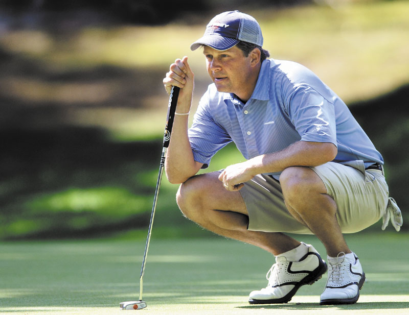 IN POSITION: Jason Gall sizes up a putt during the second round of the Maine Amateur Championship on Wednesday at the Portland Country Club in Falmouth. Gall is three shots behind leader Ryan Gay.