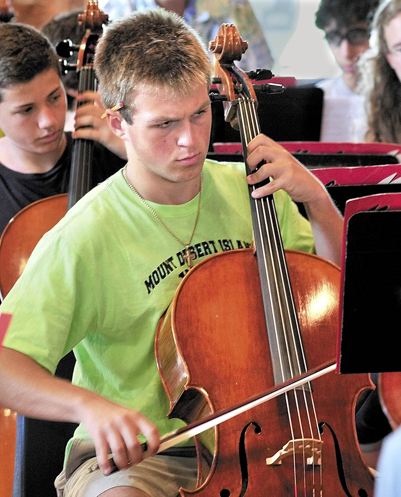 INTENT: Madison Luck of Mount Desert Island plays cello at Alumni Hall at the New England Music Camp in Sidney.