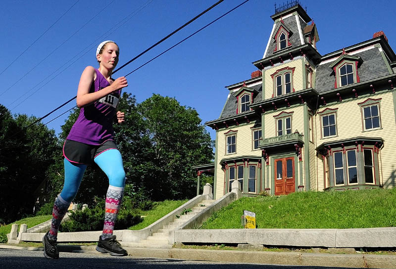 Caidyn Wilson runs past the Bodwell House on her way to being the first female finisher at the Old Hallowell Day Five Kilometer Race on Saturday morning. The 3.1 mile course started on Water Street and then alternated north and southbound legs on Second and Middle Streets on the way to a finish line in Vaughan Field.
