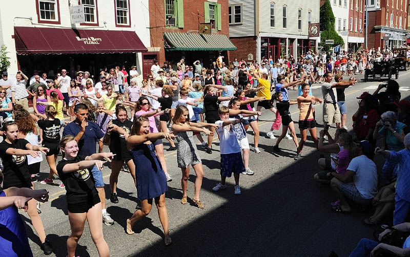 Dancers from Vicki's School of Dance perform in front of the judges' stand during the Old Hallowell Day parade on Saturday morning.
