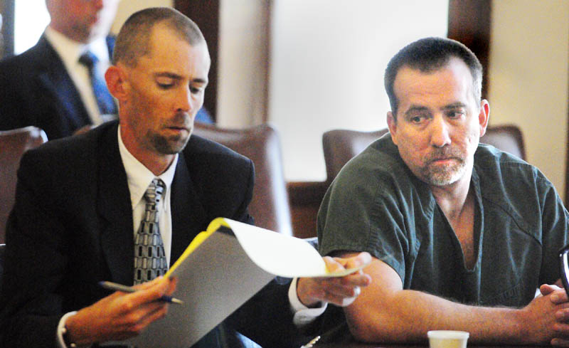 Robert MacMaster, right, confers with his attorney Sean Farris on Friday morning in Kennebec County Superior Court in Augusta. He was sentenced to four years, all but one-and-a-half years suspended, after being convicted by a jury of sexual abuse of a minor.