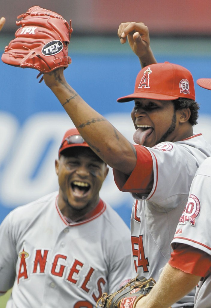 NO-HITTER: Los Angeles Angels starting pitcher Ervin Santana, right, and shortstop Erick Aybar (2) celebrate after Santana pitched a no-hitter against the Cleveland Indians on Wednesday in Cleveland. Santana allowed an unearned run in the first inning and the Angels won 3-1.