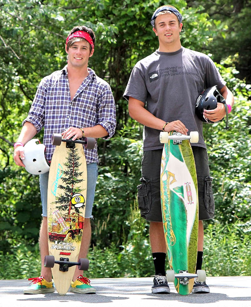 Connor Reeves, left, and Jacob Weese, both 17 and from Skowhegan, will be riding their longboards to Old Orchard Beach with their friend Ethan Johnson, 16, of Skowhegan, to raise awareness about breast cancer and raise money for the Susan G. Komen for the Cure foundation.