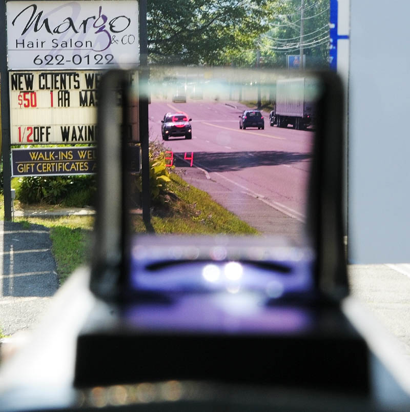 The viewfinder of the laser gun displays a cross hairs and the vehicles speed during a speeding enforcement detail Friday morning on Western Avenue in Augusta.