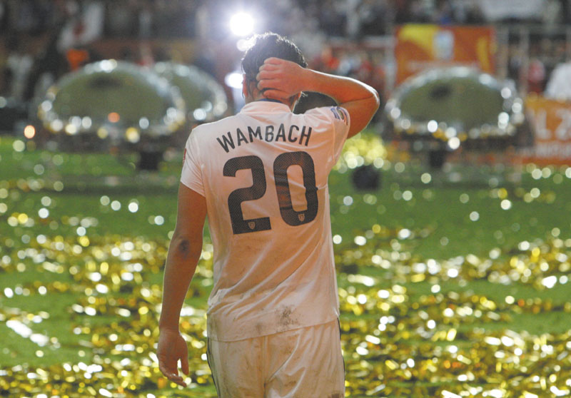 WALK TALL: Abby Wambach walks on the pitch after the U.S. women's soccer team lost to Japan in a shootout in the Women's World Cup final Sunday in Frankfurt, Germany.