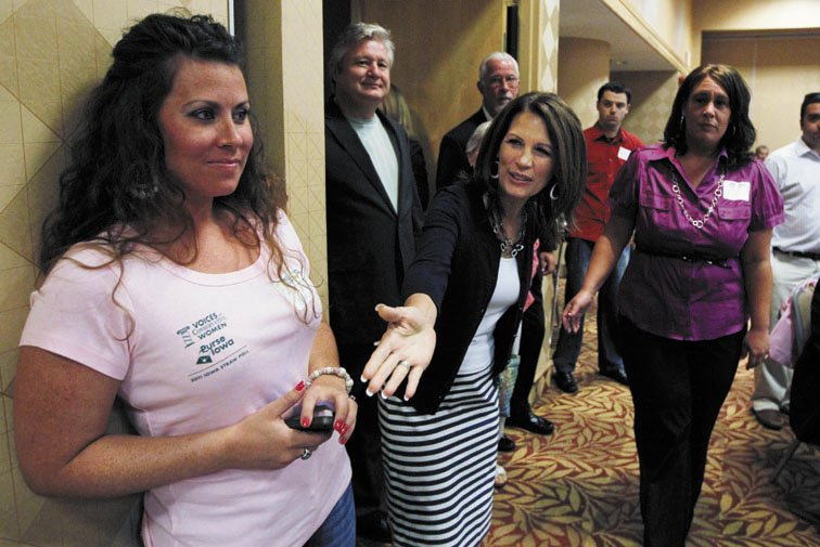 CONTENDER: Presidential candidate U.S. Rep. Michele Bachmann, R-Minn., center, arrives at a breakfast before the Iowa Republican Party's straw poll Saturday in Ames, Iowa. Rep. Bachmann was victorious in the poll.