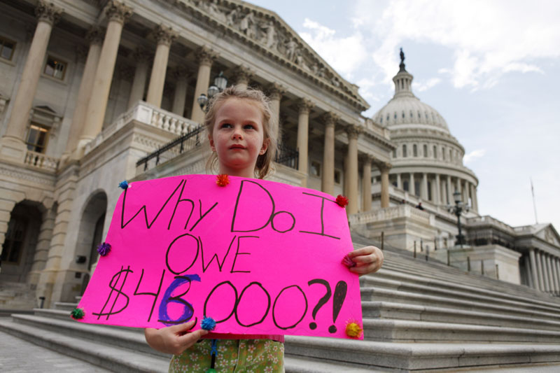 LITTLE VOICE: Holly Matthews, 7, of Kansas City, Mo., holds a sign supporting a balanced budget amendment just before the House would vote to pass debt legislation on Capitol Hill in Washington on Monday.