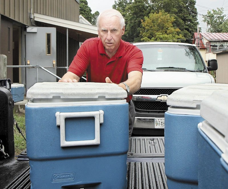 A VOLUNTEER EFFORT: Gilman Pelletier loads 300 dinners into his truck to take to Skowhegan while volunteering for Meals of Wheels on Thursday morning. Pelletier was recently given the 2011 Spirit of America Volunteer Award at a Waterville City Council meeting for his volunteer work.