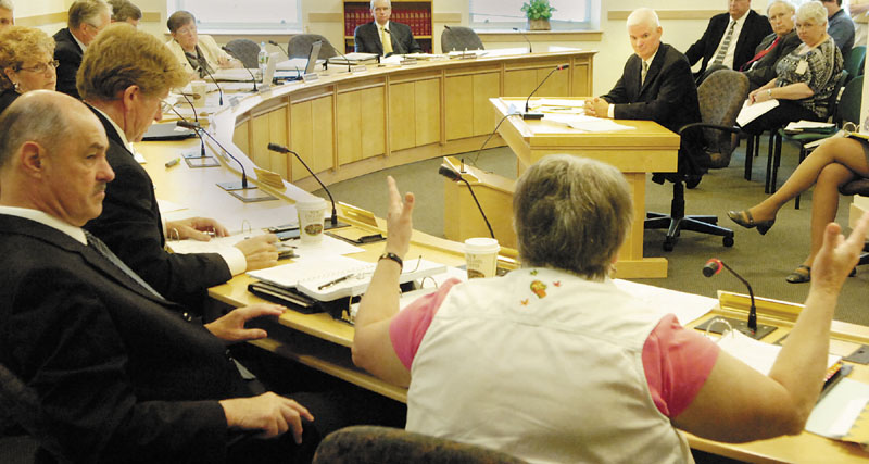QUESTION: State Sen. Nancy Sullivan, D-Biddeford, bottom right, asks Chip Gavin, former Bureau of General Services Director, a question during a Government Oversight Committee hearing about the Thomaston land sale on Tuesday morning in Augusta.