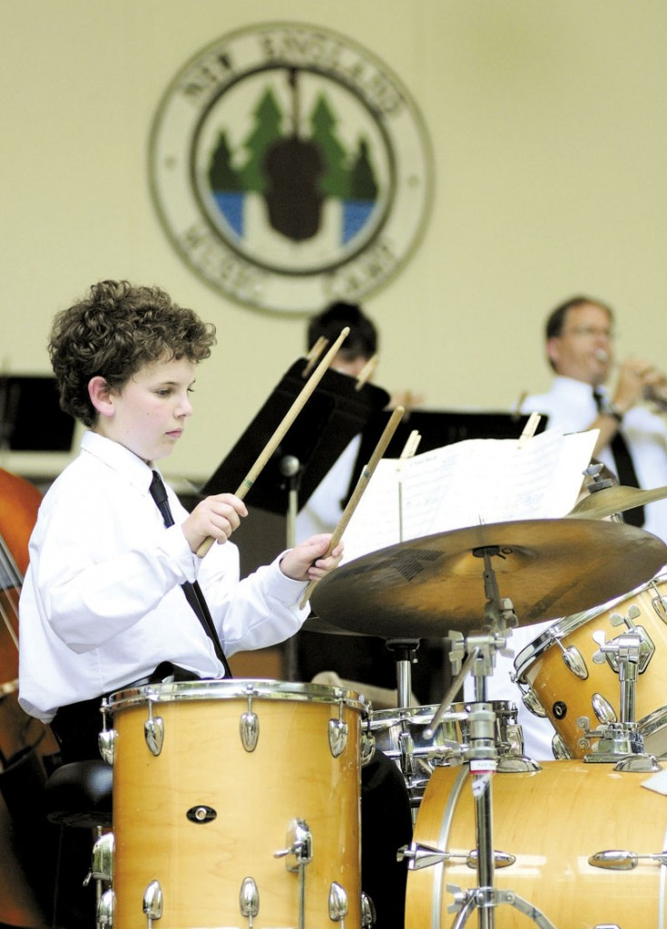 PERCUSSIONIST: David O'Sullivan, 12 of Millburn, N.J., plays the drum set with the jazz band during a concert in the Bowl in the Pines on Saturday afternoon at New England Music Camp in Sidney.