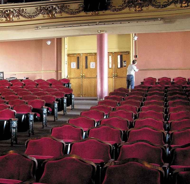IN THE HOUSE: Dave Higgins, a city custodian, is seen inside the Waterville Opera House on Friday. Opera house officials announced Friday they had met a challenge grant from the Harold Alfond Foundation as part of a $4.3 million renovation and expansion of the building.
