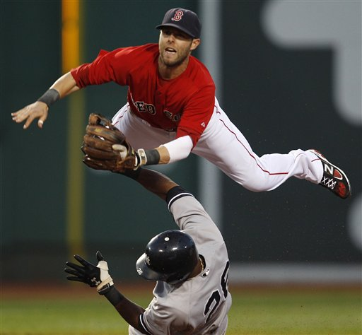 Boston Red Sox second baseman Dustin Pedroia, top, leaps over New York Yankees' Eduardo Nunez as he makes the force on a single by Derek Jeter in the third inning of a baseball game at Fenway Park in Boston, Friday, Aug. 5, 2011. (AP Photo/Charles Krupa)