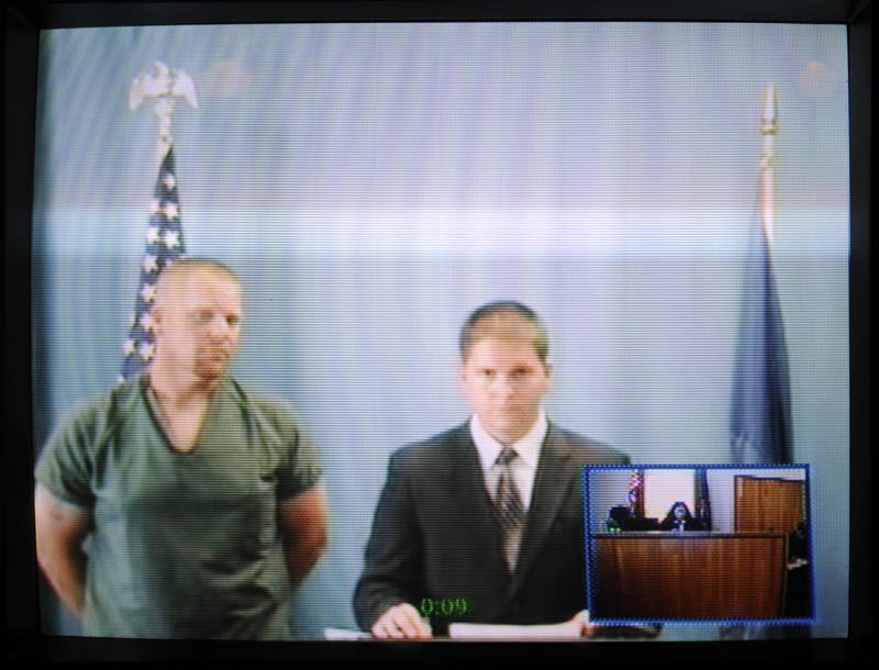 IN COURT: James Bickford, left, appears in a video conference with his attorney, Tyler Smith, from the Kennebec County jail during an initial appearance at the Kennebec County Superior Court in Augusta on charges of robbery, gross sexual assault, burglary and assault from an incident that occurred Friday in China. Bickford, 33, is being held on $250,000 bail.