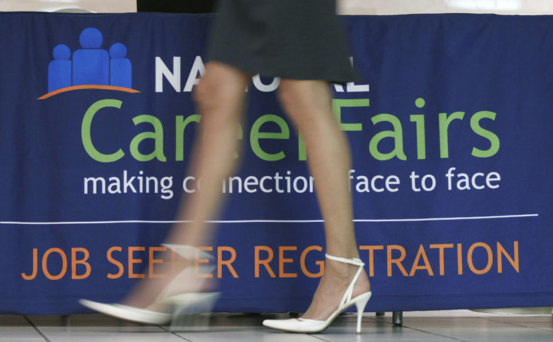 A job seeker enters a career job fair in Arlington, Va. on Thursday. The Labor Department announced today that hiring picked up slightly in July and the unemployment rate dipped to 9.1 percent as employers added 117,000 jobs.