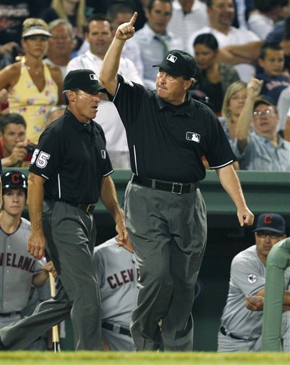 Umpire crew chief Gerry Davis signals a home run by Cleveland Indians' Asdurbal Cabrera after watching video replays, during the eighth inning of the Indians' 9-6 win over the Boston Red Sox on Monday at Fenway Park in Boston.