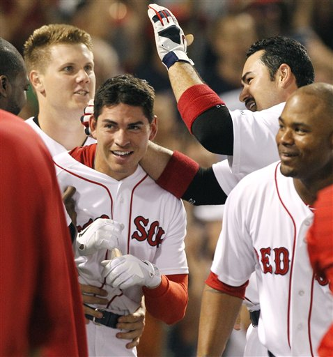 Boston's Jacoby Ellsbury, second from left, is congratulated by teammates, from left, Jonathan Papelbon, Adrian Gonzalez and Carl Crawford after he hit a walk-off home run in the ninth inning to defeat the Cleveland Indians 4-3 Wednesday night at Fenway Park in Boston.