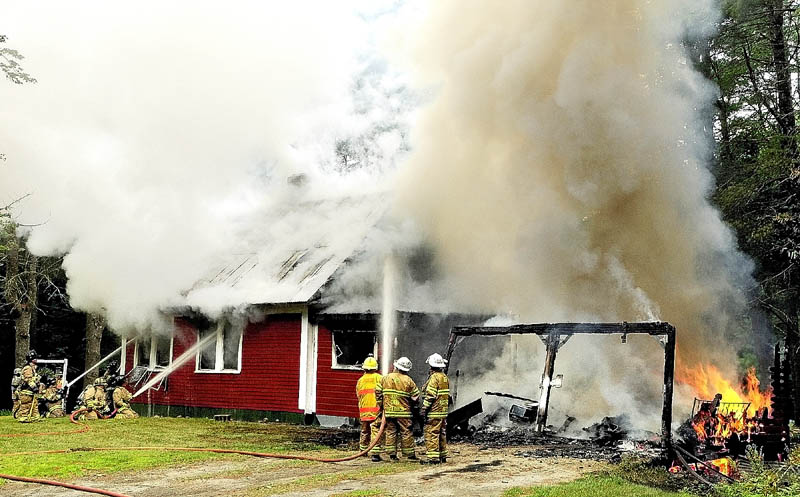 Firefighters from several area towns battle a house fire on Wings Mills Road on this afternoon in Mount Vernon.