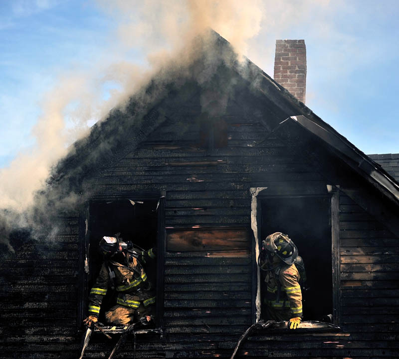 Staff photo by Michael G. Seamans Forty firefighters from four agencies including Waterville, Winslow, Fairfield and Oakland Fire Departments, responded to a house fire on Oak Street in Waterville Tuesday morning. No injuries were reported.