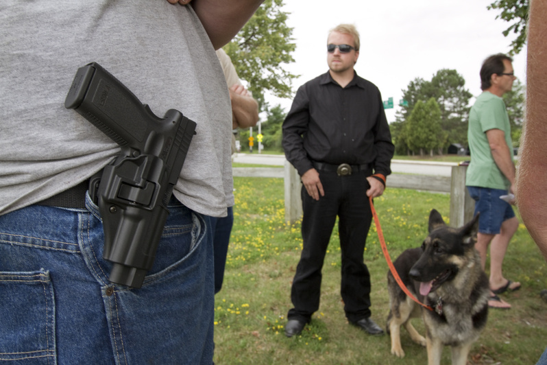 Supporters of the Maine Open Carry Association gather near Back Cove in Portland today to show support for the right to carry holstered firearms in public.