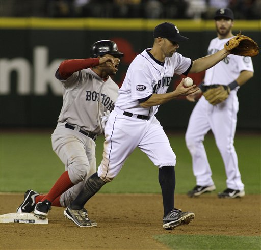 Boston Red Sox' Darnell McDonald, left, protests after he was forced at second by Seattle Mariners' Jack Wilson, center, in the eighth inning of a baseball game, Saturday, Aug. 13, 2011, in Seattle. (AP Photo/Ted S. Warren)