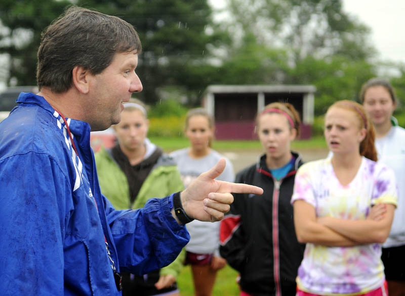 THE POINT: Richmond High School girls soccer coach Troy Kendrick address his players Monday during the defending Class D champions first day of practice. Athletes at schools across Maine took to soggy fields for the commencement of the 2011-2012 high school sports season.