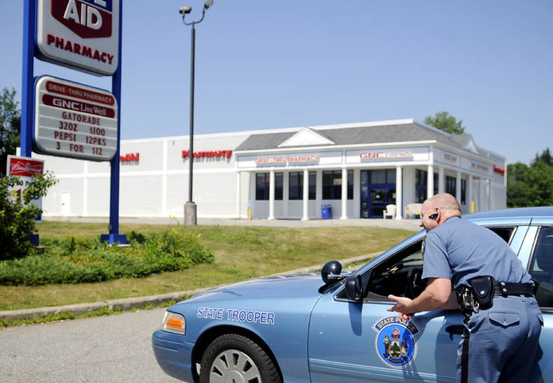 Maine State Police Lt. Donald R. Pomelow, right, speaks to trooper Jeff Beach Monday outside the Manchester Rite Aid following a robbery at the store that occurred at approximately 11 a.m.