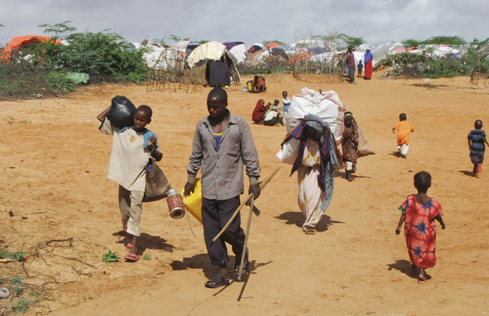 A Somali family from southern Somalia arrives in a refugee camp in Mogadishu, Somalia, today. The United Nations says famine will probably spread to all of southern Somalia within a month and force tens of thousands more people to flee into the capital of Mogadishu.