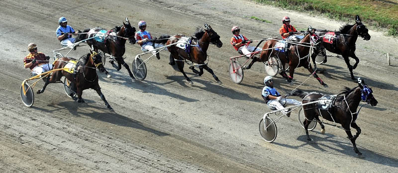 OUT IN FRONT: Kevin Switzer Jr., drives Western Comfort (5) to the lead at the halfway point of the Walter H. Hight Invitational on Saturday at the Skowhegan State Fair Saturday. Western Comfort held on to pick up the victory.