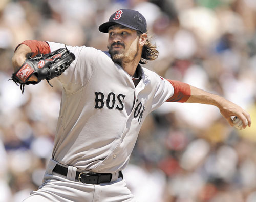 GOOD OUTING: Boston Red Sox starter Andrew Miller delivers a pitch against the Chicago White Sox during the first inning Sunday in Chicago. Miller went 52⁄3 innings, allowing three runs on 10 hits, striking out eight and walking one.