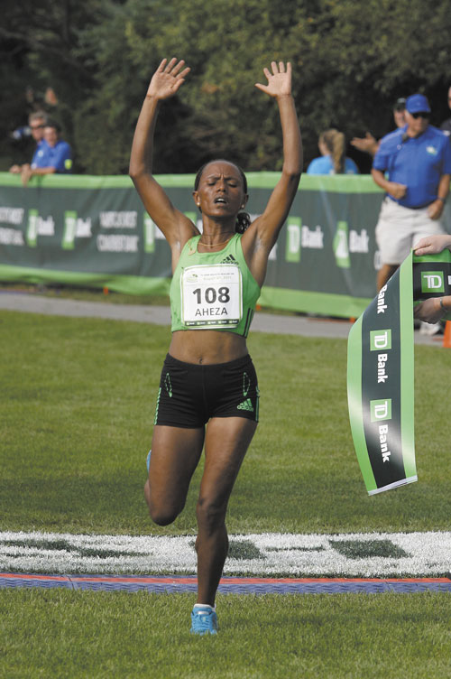 MADE IT: Aheza Kiros of Ethiopia crosses the finish line Saturday to win the 14th annual TD Bank Beach To Beacon 10K in Cape Elizabeth. Kiros finished in 32 minutes, 8.3 seconds.