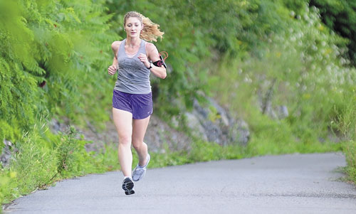 GETTING READY: Lauren LaRochelle runs on the Kennebec River Rail Trail on Wednesday in Hallowell. LaRochelle will be running in the Beach to Beacon 10K on Saturday.