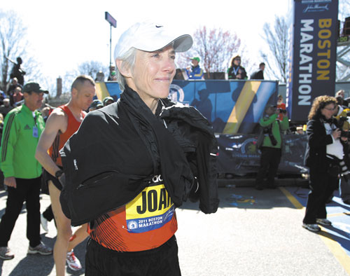 STILL RUNNING: Beach to Beacon 10K founder Joan Benoit Samuelson stands at the starting line for the Boston Marathon this spring. Samuelson is not running the Beach to Beacon on Saturday, but has been plenty busy this year.